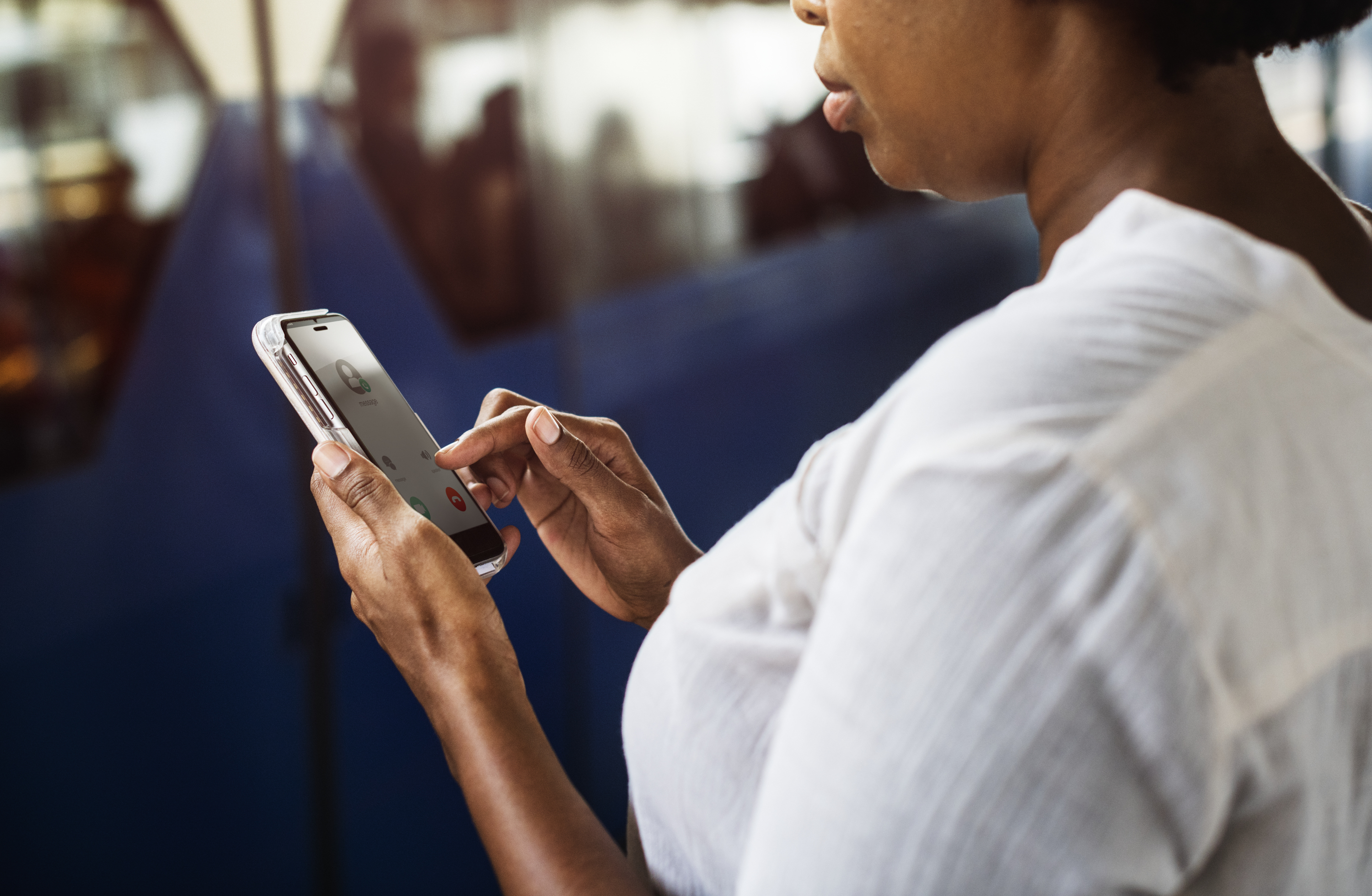 This image is a representation of a social worker checking her phone.